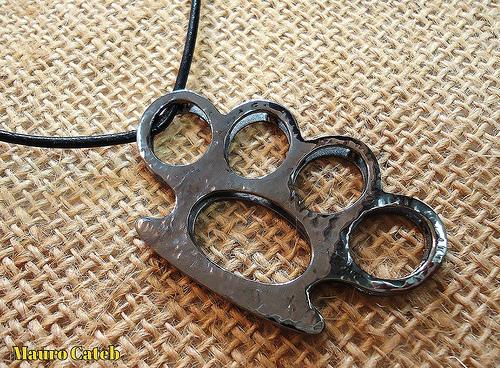 Brass knuckles pendant